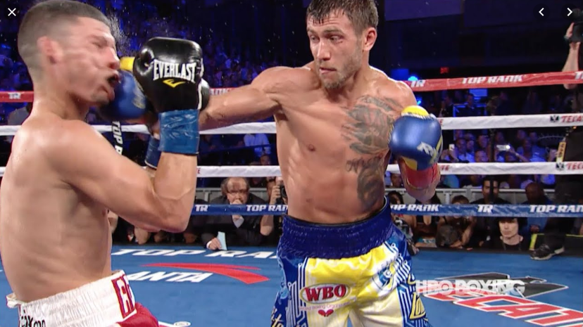 Lomachenko punching an opponent